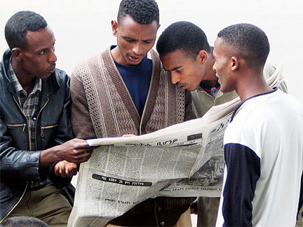 Photo-of-people-reading-a-newspaper-7b5663565d796aa4_large