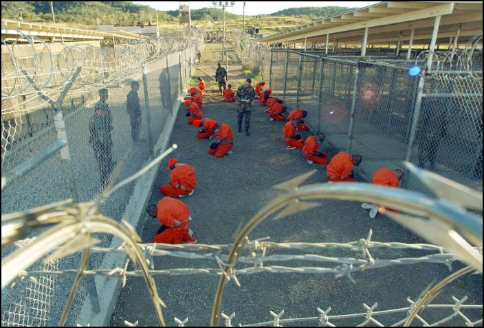 Guantanamo_captives_wait_during_processing_on_january_11th_2002