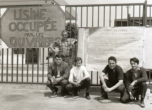French_workers_with_placard_during_occupation_of_their_factory_1968